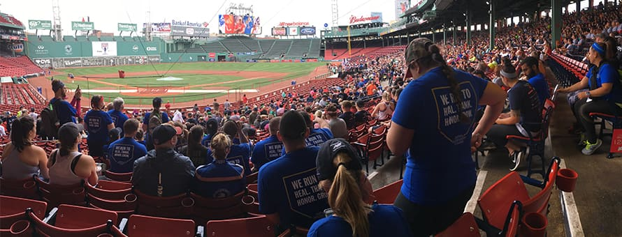 Runners from SNHU in the stands of Fenway Park before the 8th Annual Run to Home Base race.